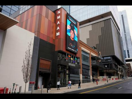 People walk to the entrance of the National Museum of African American Music, in Nashville, Tenn. Unlike other museums that focus on a genre or label, this new museum is the first to span multiple genres including gospel, blues, jazz, R&B and hip hop.
