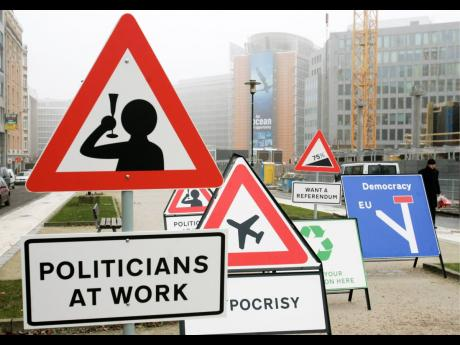 Spoof road signs are erected in front of the European Commission headquarters in Brussels, December 13, 2007, around the time when the parties were initialling the EU-Cariforum trade agreement.