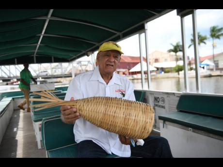 Joseph Charles Swaby explains how the shrimp traps operate, while leading a tour of the Black River Safari in St Elizabeth.