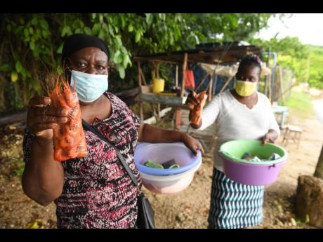 For more than 30 years, Johana Peart (left), has been selling shrimps in Middle Quarters, St Elizabeth.