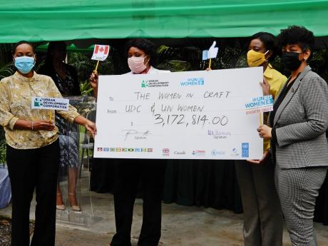 From left: Marsha Smith, state minister, in the Ministry of Finance and Public Service; Maxine Smith-White, of Dunn's River Falls and Park; Shyrell Lewis, TPDCo, and Heather Pinnock, general manager, UDC with the symbolic cheque.