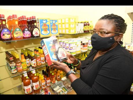 Brenda Greene, zonal senior economics officer at Agri-mart, shows some of the items that are made from natural, local products..