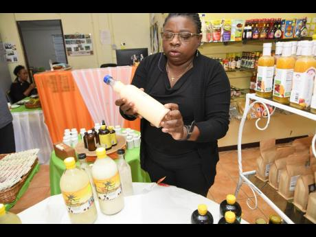 Brenda Green of RADA Agrimart shows off some of the natural products that are sold at the Old Hope Road facility.