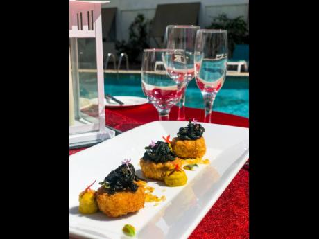 Chickpeas fritters with curried eggplant purée and wilted greens.