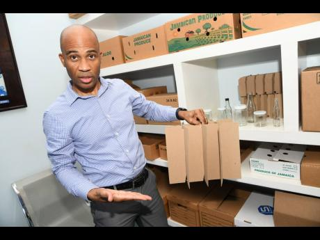Sterling Packaging Limited CEO Edgar Booby Stone shows off partitions made by his company, a product he credits with setting Sterling apart from the competition, on February 8, 2021.