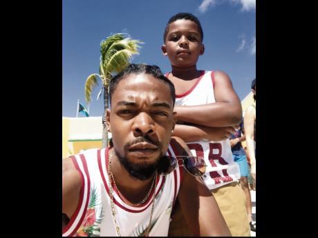 Reuben Shaw takes a quick selfie with his son Eriq.