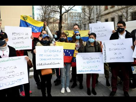 People protest against the extradition of Venezuelan Ernesto Quintero in Madrid, Spain, yesterday.