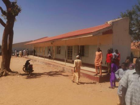 People gather inside the Government Science Secondary School in Kankara, Nigeria, last year December. Nigerian police say that hundreds of students are missing after gunmen attacked the secondary school in the country's northwestern Katsina state.