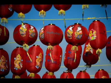 Lanterns hang across the street to celebrate the Chinese Lunar New Year which marks the Year of the Ox, in the Chinatown district of central London.