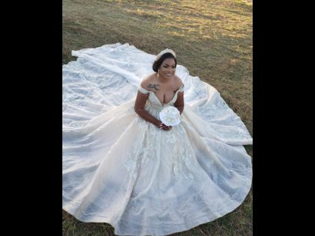The bride ditched the traditional white and opted for a deep champagne coloured off the shoulder shiny ball gown with beautiful lace and beading. She also went with a matching veils, gold crown and earrings.