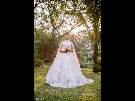 This nuptial queen stole the show in her majestic cape gown with flower and sequin details.