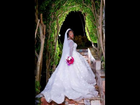 CEO of LuxBrides Ja, Samantha Grant-Robinson, glowing on her wedding day.