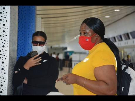 Kidnap hoaxer Kalina Collier (left), who spawned a viral rumour that she was being held hostage at a Jamaican hotel, is seen beside her Jamaica-born mom Candice Walker, who drove her to the Sangster International Airport in Montego Bay to catch her flight