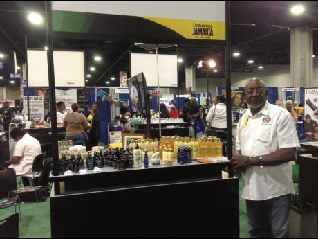 Professor Harvey Reid displays his products at the JAMPRO Pavillion at the Bonner Brothers International Hair Show, Atlanta, USA, in August 2018.