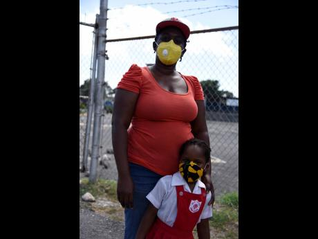 right: Shantal Collins-Grant says that as long as West Indies Basic School is following the protocols, her three-year-old daughter, La'Tivia Grant, should be fine.