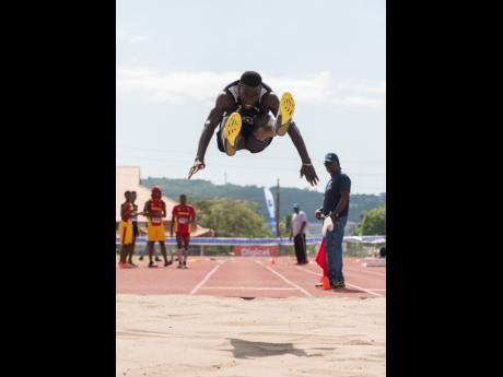 Jamaica College's (JC) Apalos Edwards in action in the Class One Boys long jump at the Purewater/JC/R Danny Williams Track Meet at Ashenheim Stadium at JC in St Andrew on Saturday, January 4, 2020.