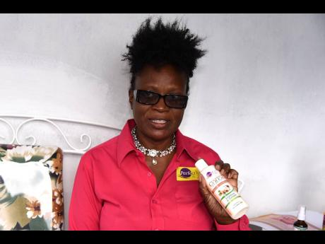 Owner and operator of Perfect Hair and Skin, Denese Hamilton, shows off her line of skin and hair care product.