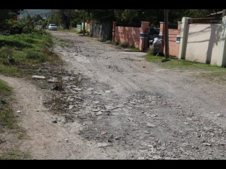 Alamando Terrace in New Haven, St Andrew, bears evidence of the havoc wreaked by torrential rainfall.