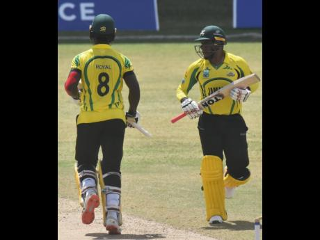 Jamaica Scorpions batting duo of Jeavor Royal (right) and Fabian Allen in action against the Leeward Islands Hurricanes during their Cricket West Indies Regional Super50 game at the Sir Vivian Richards Stadium in Antigua yesterday.
