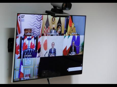 A general view of the video screen of G7 leaders as European Commission President Ursula von der Leyen and European Council President Charles Michel prepare to take part online at the European Council building in Brussels on Friday, February 19, 2021.