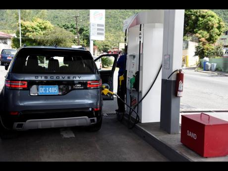 This active gas pump was left unattended at this service station visited last week.
