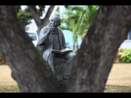 A statue of Sir Philip Sherlock at the Mona Campus of The University of the West Indies. University leaders have called for their staff and students to be among the second-string cohort to receive the coronavirus vaccine.