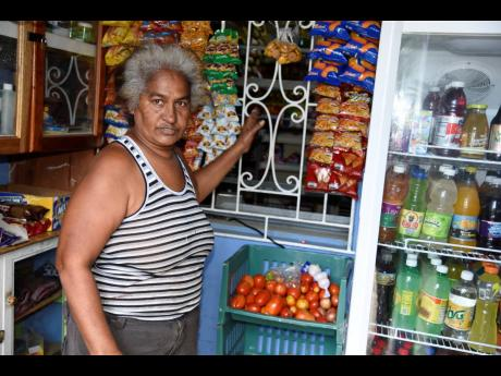 Charmaine Ferguson, a shopkeeper in Patrick City, says she has to compensate for the lack of customers by selling ground provisions.