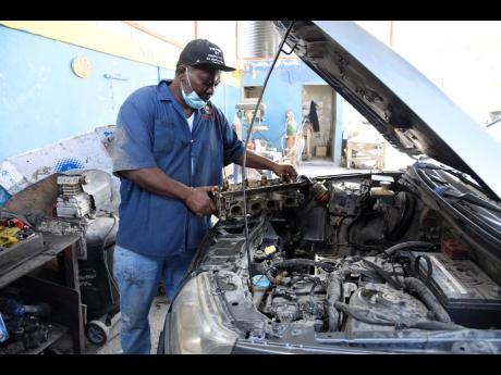 Mechanic Genton Myrie laments the depletion of his customer base.