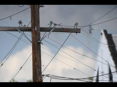 Illegal throw-up wires are seen connected to Jamaica Public Service Company lines along East Street in Kingston on Sunday.
