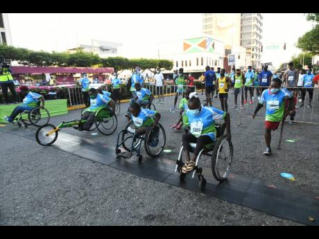 Racers at the start of the Sagicor SIGMA Corporate Run on Knutsford Boulevard, St Andrew, yesterday.