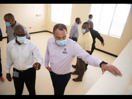 Wentworth Charles (left), chairman of the South East Regional Health Authority, and Minister of Health and Wellness Dr Christopher Tufton tour the recently constructed COVID-19 field hospital located at St Joseph's Hospital in Kingston on February 11.