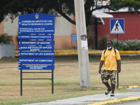 A man walks on the campus of The University of the West Indies, Mona on Sunday.