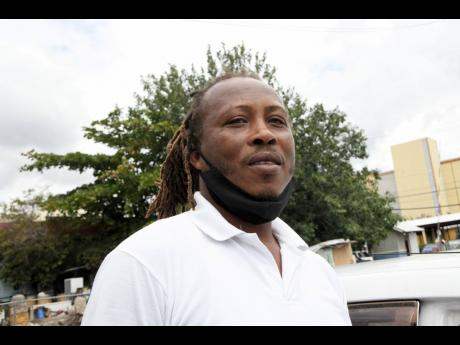 """Wayneworth Walters, a taxi operator, says that the JUTC should consider smaller units """"to go 'round town and the bigger buses go like country"""" because of loss-making factors such as wear and tear."""