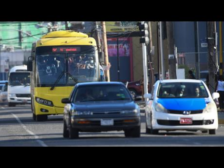 A Jamaica Urban Transit Company bus transports passengers along Half-Way Tree Road in St Andrew. The state-run organisation has come under pressure from the Jamaica Association of Transport Owners and Operators, which has criticised the Government's pers