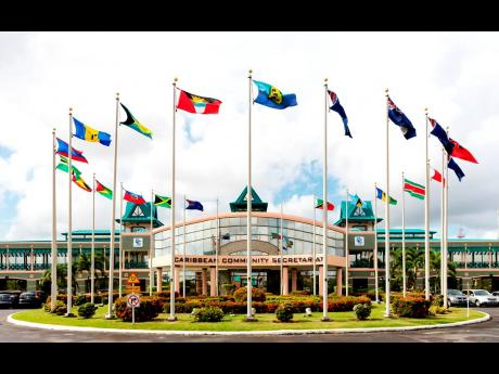 The flags of Caricom members fly at the secretariat in Georgetown, Guyana.