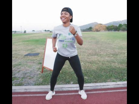Jhana Edwards, senior sponsorship and promotions officer, Supreme Ventures, participates in a warm-up session before starting her walk. The Supreme Ventures team completed their virtual 5k run and walk on the track at the Calabar High School with TrainFit