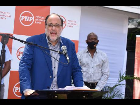Opposition Leader Mark Golding addresses a press conference on Tuesday addressing the JAMCOVID data exposure and Jamaica's vaccination campaign.