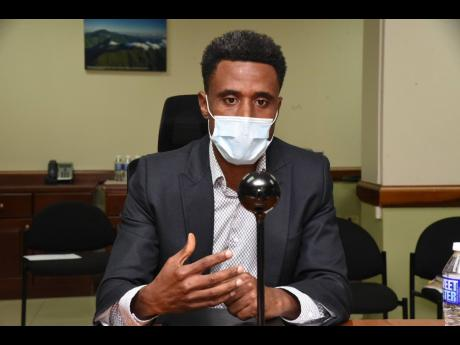 The new chairman for the Cannabis Licensing Authority, LeVaughn Flynn, addresses a meeting at the Ministry of Industry, Investment and Commerce on Tuesday.