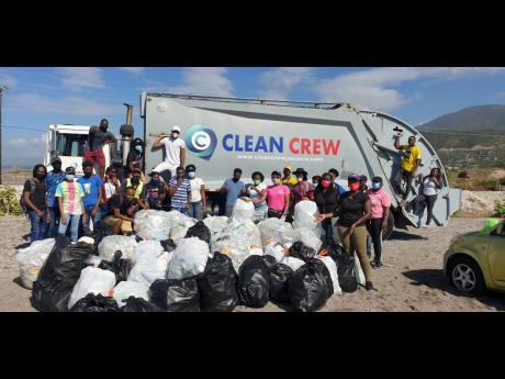RCOK team members share a photo moment with volunteers before loading the Clean Crew truck with some 85 bags of plastic and other waste collected in a 200-metre radius.