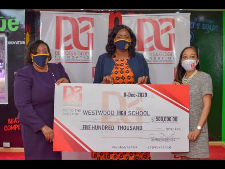 From left: Karen Francis, principal of Westwood High School, and Natalia Whyte, teacher at the school, receive a cheque valued at $500,000 from Dianne Ashton-Smith, board member of the Desnoes and Geddes (D&G) Foundation. The organisation made the donation