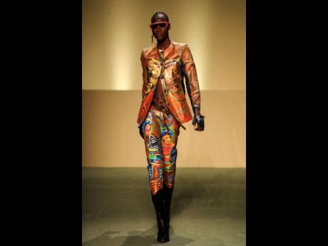 Pape Macodou Fall, whose 'nom de artiste' is Mokodu, took existing garments and upcycled them with hand-painted African-inspired images as part of the Black Lives Matter Fall/Winter 2021/22 collective fashion show.