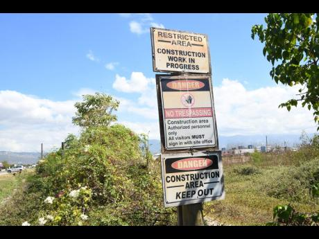 Despite the signs warning of construction taking place, the 15-acre property still sits undeveloped.