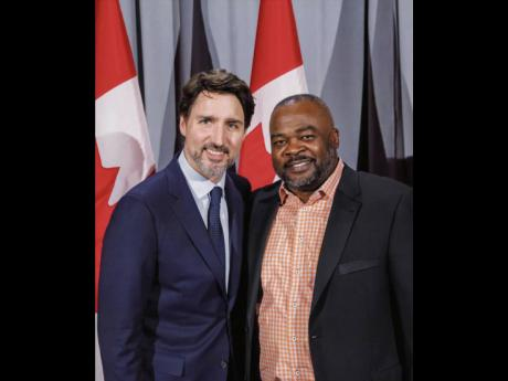 Chris Campbell (right), equity and diversity representative of the Carpenters' District Council of  Ontario, is photographed with Justin Trudeau, prime minister of Canada.