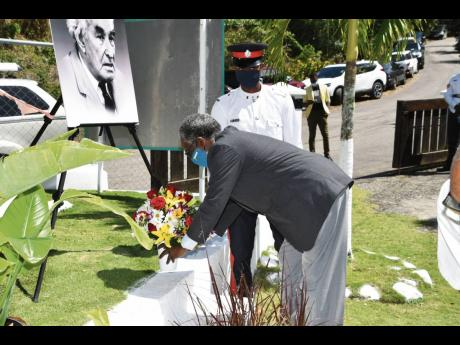 Custos of Hanover, Dr David Stair, lays a floral tribute to mark the 137th anniversary of the birth of National Hero Sir Alexander Bustamante, at his birthplace on February 24.
