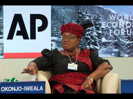 """Ngozi Okonjo-Iweala during a panel discussion """"The Post-2015 Goals: Inspiring a New Generation to Act"""", the fifth annual Associated Press debate, at the World Economic Forum in Davos, Switzerland. Okonjo-Iweala was appointed to head the World Trade Organiz"""