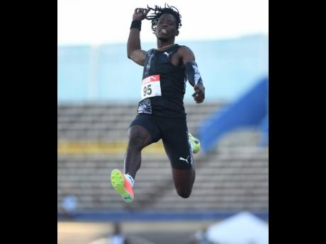 World Champion Tajay Gayle competes in the long jump event at the Jamaica Athletics Administration Association Qualification Trial, held at the National Stadium in St Andrew yesterday. Gayle won the event with a jump of 8.03 metres.
