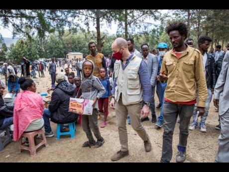 Manuel Fontaine, UNICEF Director of the Office of Emergency Programmes, centre, visits internally-displaced people in Adigrat Town, in the Tigray region of northern Ethiopia.