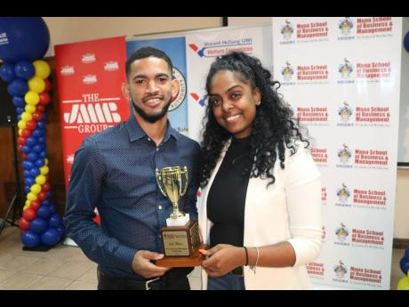 The third-prize winners in the Vincent HoSang UWI Venture Competition, Stuart Payne (left) and Cereta McDougall.