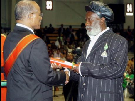 Winston 'Burning Spear' Rodney, receives his Order Of Distinction in the rank of Officer (OD) at the Ceremony of Investiture and Presentation of National Honours and awards 2007 at the National Indoor Sporting Centre on National Heroes Day Monday, Octo