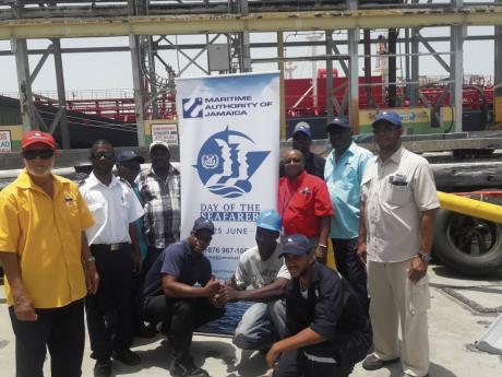Tugboat crew from Portside Towing at the Maritime Authority of Jamaica's 'Day of the Seafarer' event in 2018.